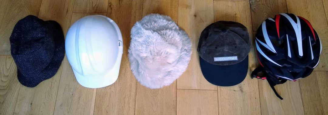 different hats representing different responsibilities